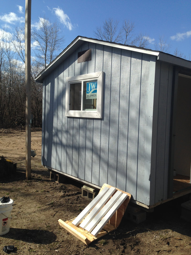 We installed a south facing window on the chicken coop for solar gain